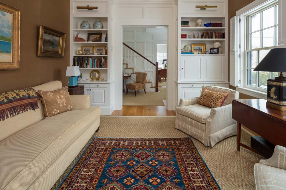 A Clic Geometric Caucasian Design Carpet Accents The Overall Sisal Floor Covering Providing Real Snap Of Color