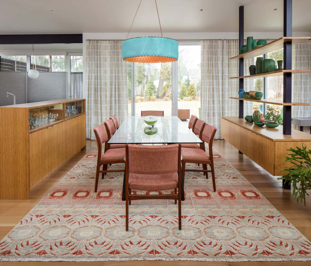 An Ikat Rug Hand Woven In Afghanistan Is The Elegant Foundation For This Gl Tabled Dining Room